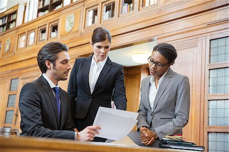 Lawyers examining documents in court Stock Photo - Premium Royalty-Free, Code: 6113-07762418