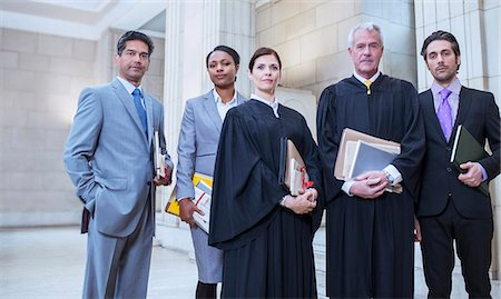 Judges and lawyers standing together in courthouse Stock Photo - Premium Royalty-Free, Code: 6113-07762423