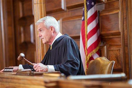Judge banging gavel in court Stock Photo - Premium Royalty-Free, Code: 6113-07762422