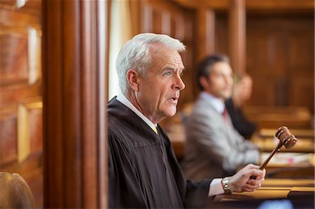 Judge banging gavel in court Stock Photo - Premium Royalty-Free, Code: 6113-07762427