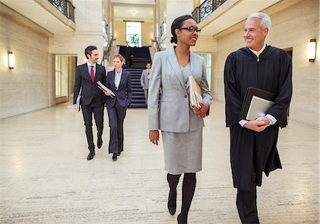 Judges and lawyers walking through courthouse Stock Photo - Premium Royalty-Free, Code: 6113-07762425