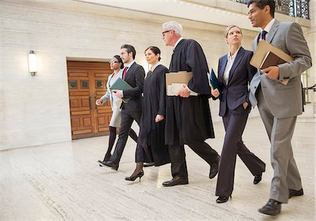 Judges and lawyers walking through courthouse together Stock Photo - Premium Royalty-Free, Code: 6113-07762432