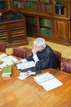 Judge doing research in courthouse Stock Photo - Premium Royalty-Free, Code: 6113-07762436