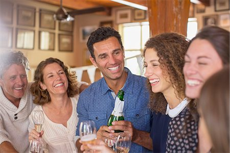 Family celebrating with drinks Stock Photo - Premium Royalty-Free, Code: 6113-07762544
