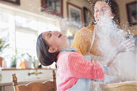 Mother and daughter playing with flour in the kitchen Stock Photo - Premium Royalty-Free, Code: 6113-07762553