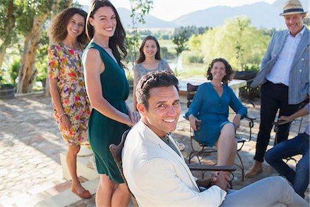 Family gathered on backyard patio Stock Photo - Premium Royalty-Free, Code: 6113-07762550