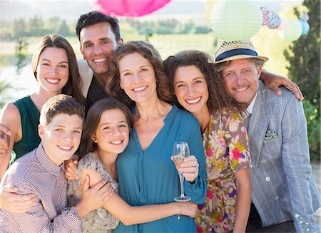 Family hugging outdoors Stock Photo - Premium Royalty-Free, Code: 6113-07762557