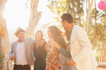 Family celebrating with drinks Stock Photo - Premium Royalty-Free, Code: 6113-07762579