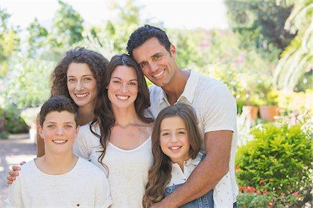 Family hugging outdoors Stock Photo - Premium Royalty-Free, Code: 6113-07762583