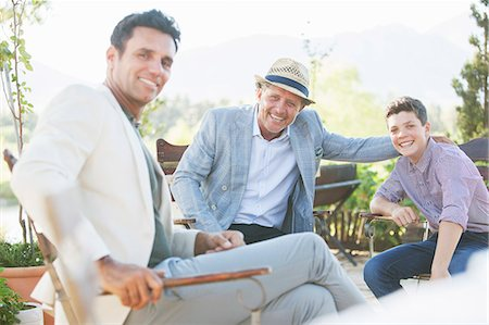Three generations of men relaxing outdoors Stock Photo - Premium Royalty-Free, Code: 6113-07762580