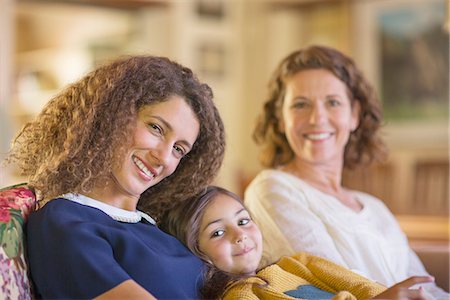 Three generations of women relaxing on couch together Stock Photo - Premium Royalty-Free, Code: 6113-07762581