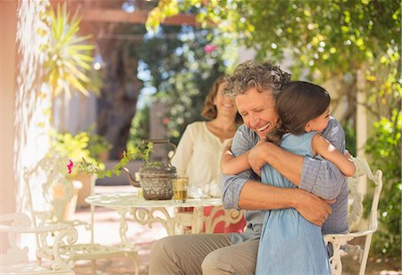 Grandfather and granddaughter hugging outdoors Stock Photo - Premium Royalty-Free, Code: 6113-07762594