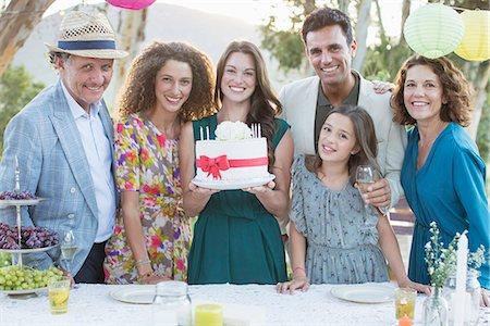 Family celebrating birthday with cake Stock Photo - Premium Royalty-Free, Code: 6113-07762501