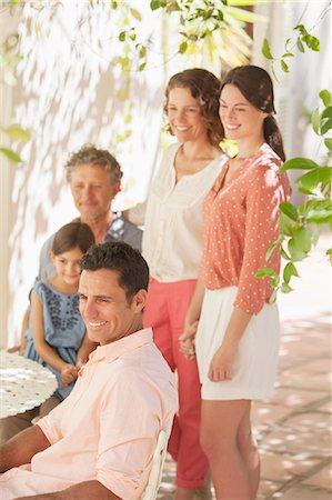 Family gathered around table outdoors Stock Photo - Premium Royalty-Free, Code: 6113-07762508