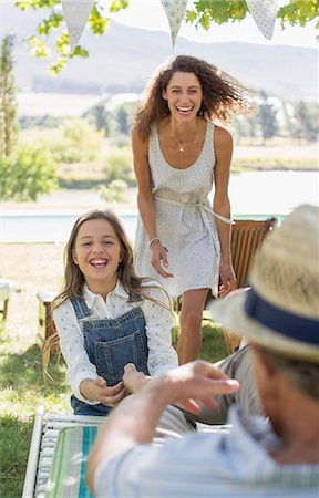 Family playing outdoors Stock Photo - Premium Royalty-Free, Code: 6113-07762509