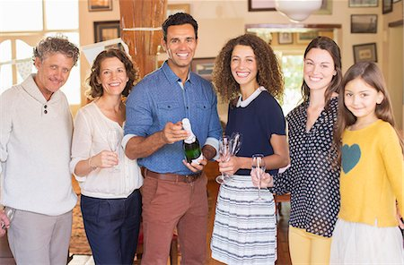 Family celebrating with drinks Stock Photo - Premium Royalty-Free, Code: 6113-07762513