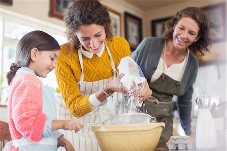 daughter middle-aged mother women young adults - Three generations of woman baking together Stock Photo - Premium Royalty-Free, Code: 6113-07762515