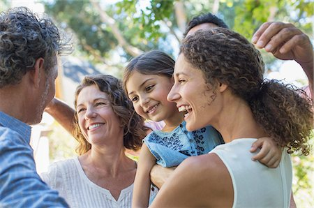 five - Family hugging outdoors Stock Photo - Premium Royalty-Free, Code: 6113-07762522