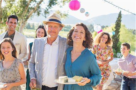 Older couple hugging at family picnic Stock Photo - Premium Royalty-Free, Code: 6113-07762526