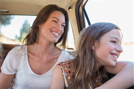 Sisters riding in car backseat together Stock Photo - Premium Royalty-Free, Code: 6113-07762537