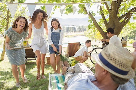 Family enjoying the outdoors together Stock Photo - Premium Royalty-Free, Code: 6113-07762536