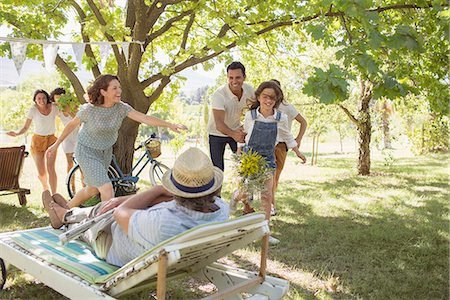 Family playing together outdoors Stock Photo - Premium Royalty-Free, Code: 6113-07762620