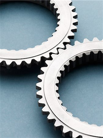 still life - Close up of interlocking metal gears Stock Photo - Premium Royalty-Free, Code: 6113-07790183