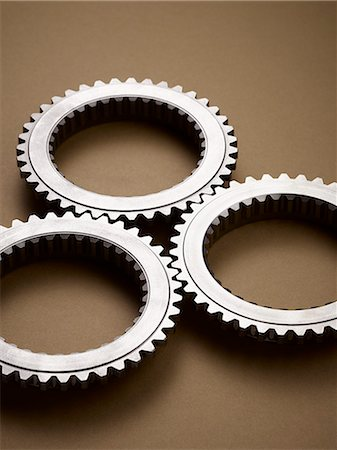 Close up of interlocking metal gears Stock Photo - Premium Royalty-Free, Code: 6113-07790187