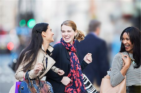 shop - Women walking together on city street Stock Photo - Premium Royalty-Free, Code: 6113-07790190