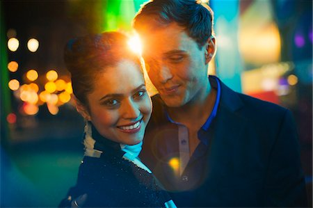 Couple hugging on city street at night Stock Photo - Premium Royalty-Free, Code: 6113-07790205