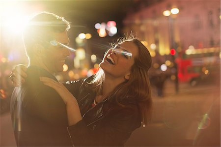Couple hugging on city street at night Stock Photo - Premium Royalty-Free, Code: 6113-07790216