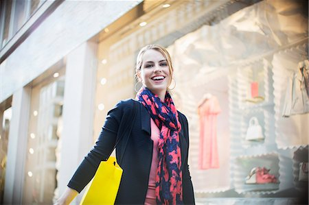 Woman shopping on city street Stock Photo - Premium Royalty-Free, Code: 6113-07790218
