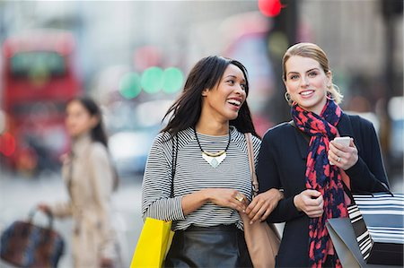 shop - Women walking together down city street Stock Photo - Premium Royalty-Free, Code: 6113-07790231