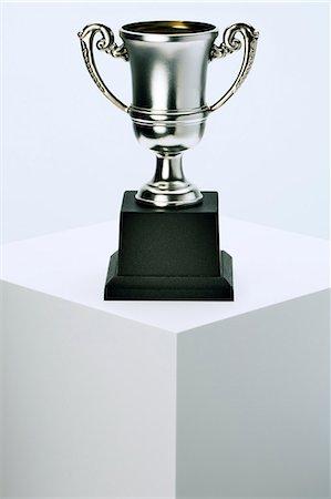 Trophy sitting on pedestal Stock Photo - Premium Royalty-Free, Code: 6113-07790396