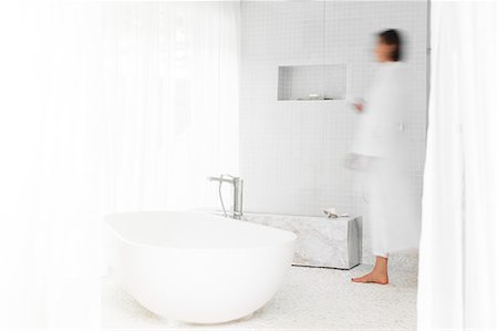 shower - Blurred view of woman walking in modern bathroom Stock Photo - Premium Royalty-Free, Code: 6113-07790555