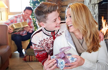 sweater and fireplace - Family exchanging gifts on Christmas Stock Photo - Premium Royalty-Free, Code: 6113-07790596