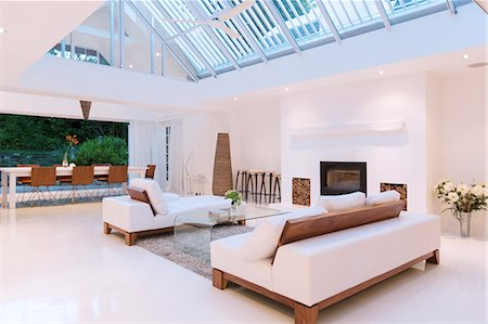Sofas, fireplace and skylights in modern living room Stock Photo - Premium Royalty-Free, Code: 6113-07790530