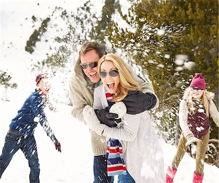 Family having a snowball fight in the snow Stock Photo - Premium Royalty-Free, Code: 6113-07790646