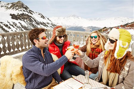 dark glasses - Friends celebrating with drinks in the snow Stock Photo - Premium Royalty-Free, Code: 6113-07790648