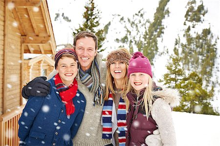 Family hugging in the snow Stock Photo - Premium Royalty-Free, Code: 6113-07790653