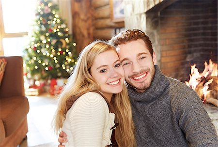 sweater and fireplace - Couple hugging in front of fireplace Stock Photo - Premium Royalty-Free, Code: 6113-07790666