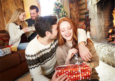 sweater and fireplace - Couple exchanging gifts on Christmas Stock Photo - Premium Royalty-Free, Code: 6113-07790668