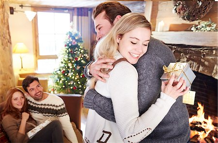 sweater and fireplace - Couple exchanging gifts on Christmas Stock Photo - Premium Royalty-Free, Code: 6113-07790669