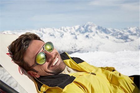 dark glasses - Man laying on a chair in the snow Stock Photo - Premium Royalty-Free, Code: 6113-07790675