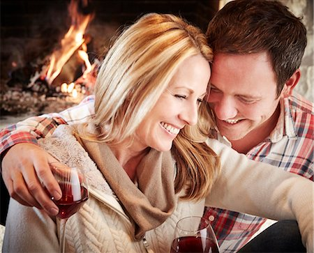 sweater - Couple enjoying drinks together Stock Photo - Premium Royalty-Free, Code: 6113-07790692