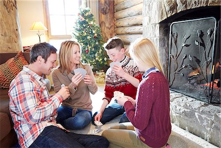 Family playing card game together Stock Photo - Premium Royalty-Free, Code: 6113-07790694