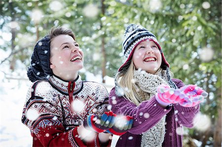 Siblings catching snow together Stock Photo - Premium Royalty-Free, Code: 6113-07790600