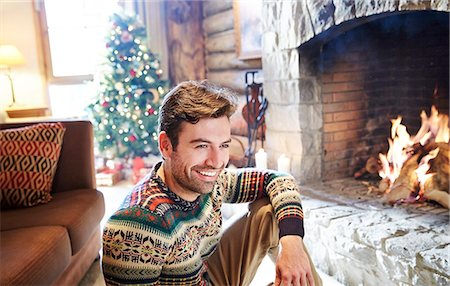 sweater and fireplace - Man in warm sweater enjoying fireplace Stock Photo - Premium Royalty-Free, Code: 6113-07790601