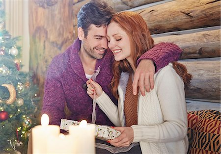 sweater - Couple exchanging gifts on Christmas Stock Photo - Premium Royalty-Free, Code: 6113-07790605