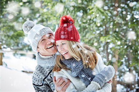 snowflakes  holiday - Couple playing in snow together Stock Photo - Premium Royalty-Free, Code: 6113-07790620